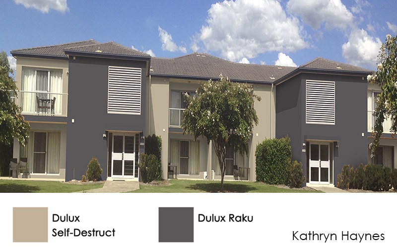 Townhouses in beige and dark grey colour scheme, matching the existing blue gutters
